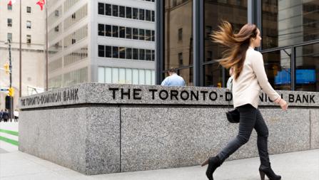 woman walking past the Toronto bank
