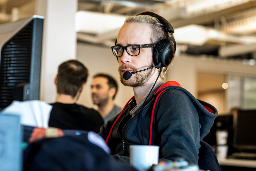 Person on headset at computer