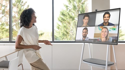 Woman having remote meeting with colleagues