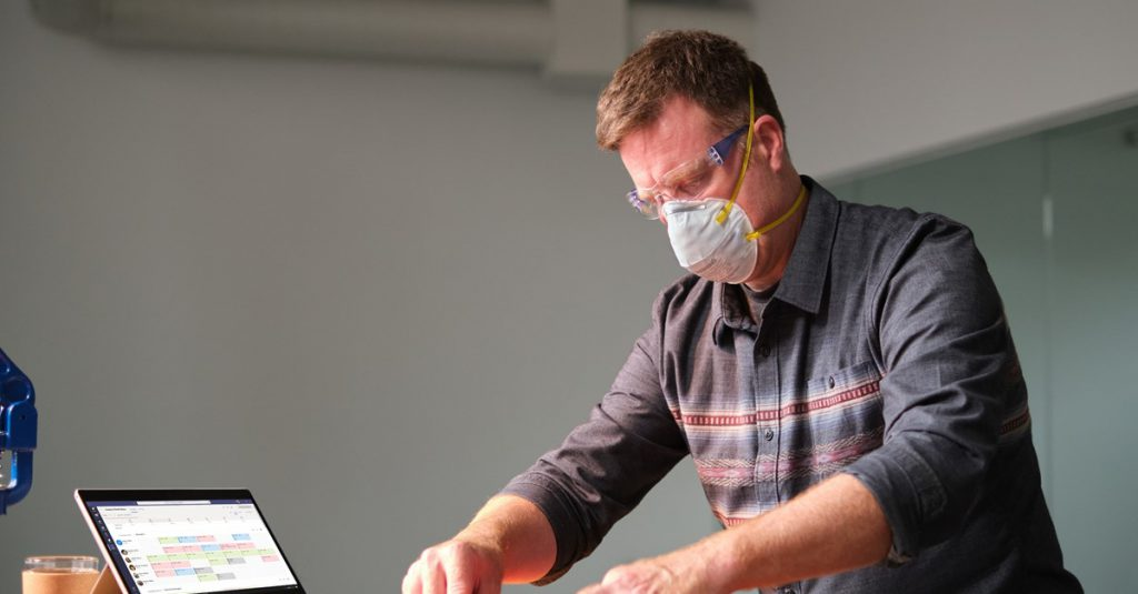 Man wearing COVID mask at work