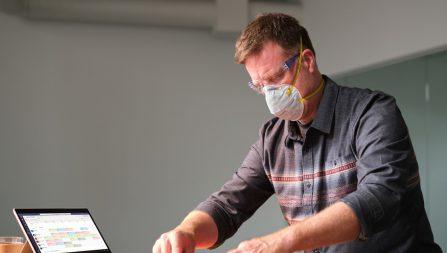 Man wearing COVID mask at work
