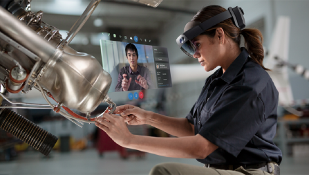 person working while on Microsoft HoloLens video conference