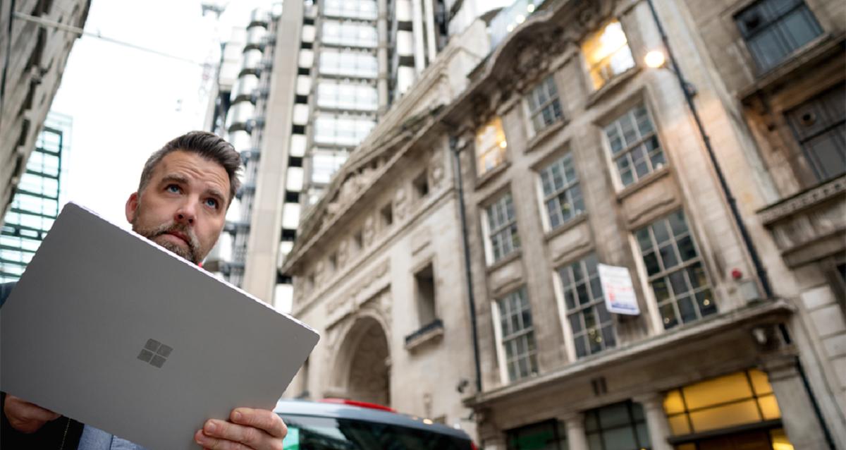 Man outside on laptop